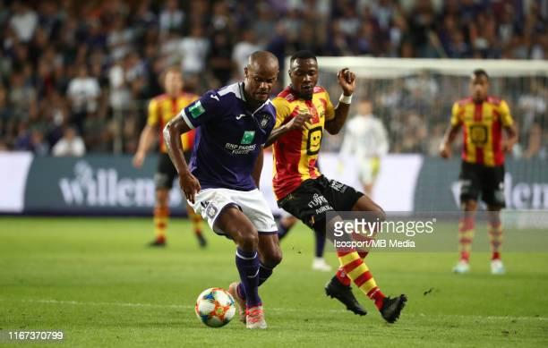 Vincent Kompany of Anderlecht battles for the ball with William Togui of Kv Mechelen during the Jupiler Pro League match between RSC Anderlecht and...