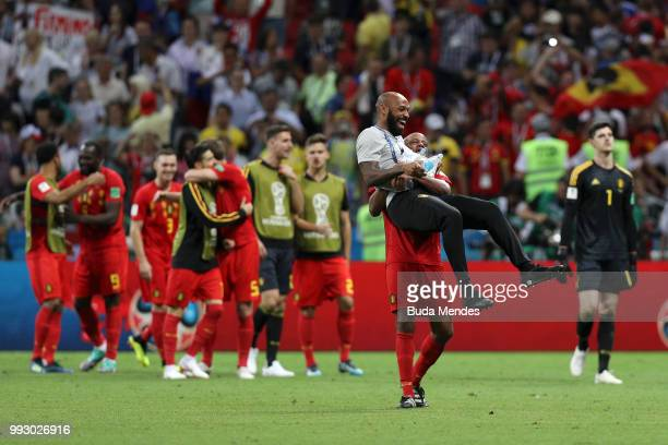 Vincent Kompany of Belgium and Belgium assistant coach Thierry Henry celebrate following their sides victory in the 2018 FIFA World Cup Russia...