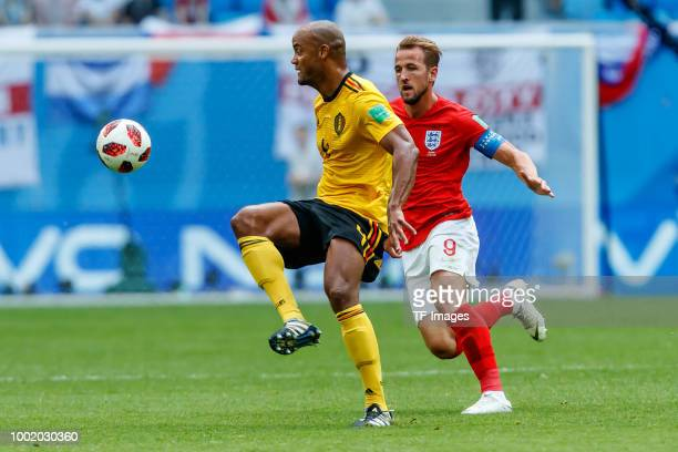 Vincent Kompany of Belgium and Harry Kane of England battle for the ball during the 2018 FIFA World Cup Russia 3rd Place Playoff match between...