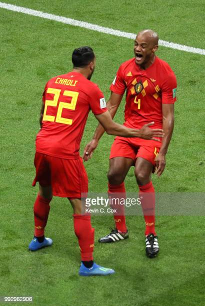 Vincent Kompany of Belgium and Nacer Chadli of Belgium celebrate after Fernandinho of Brazil scores an own goal for their sides first goal during the...