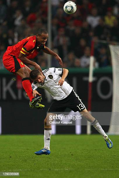 Vincent Kompany of Belgium and Thomas Mueller of Germany go up for a header during the UEFA EURO 2012 Group A qualifying match between Germany and...
