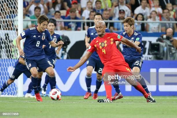 Vincent Kompany of Belgium between Genki Haraguchi Yuya Osako of Japan during the 2018 FIFA World Cup Russia Round of 16 match between Belgium and...