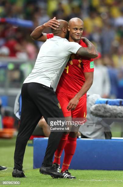 Vincent Kompany of Belgium celebrates with Belgium assistant coach Thierry Henry following an own goal from Fernandinho of Brazil Belgium's first...