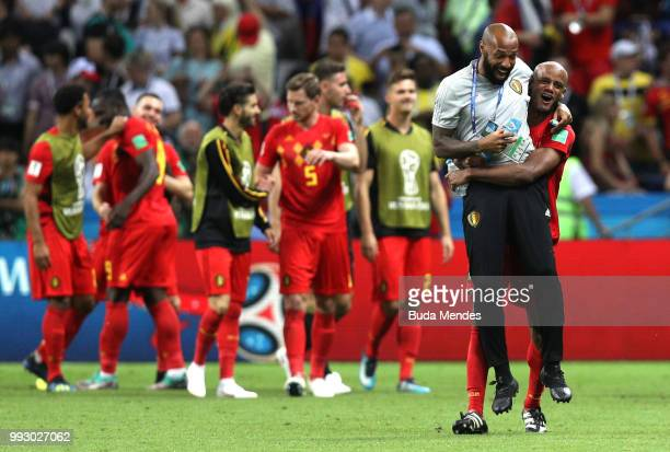 Vincent Kompany of Belgium celebrates with Belgium assistant coach Thierry Henry following the 2018 FIFA World Cup Russia Quarter Final match between...