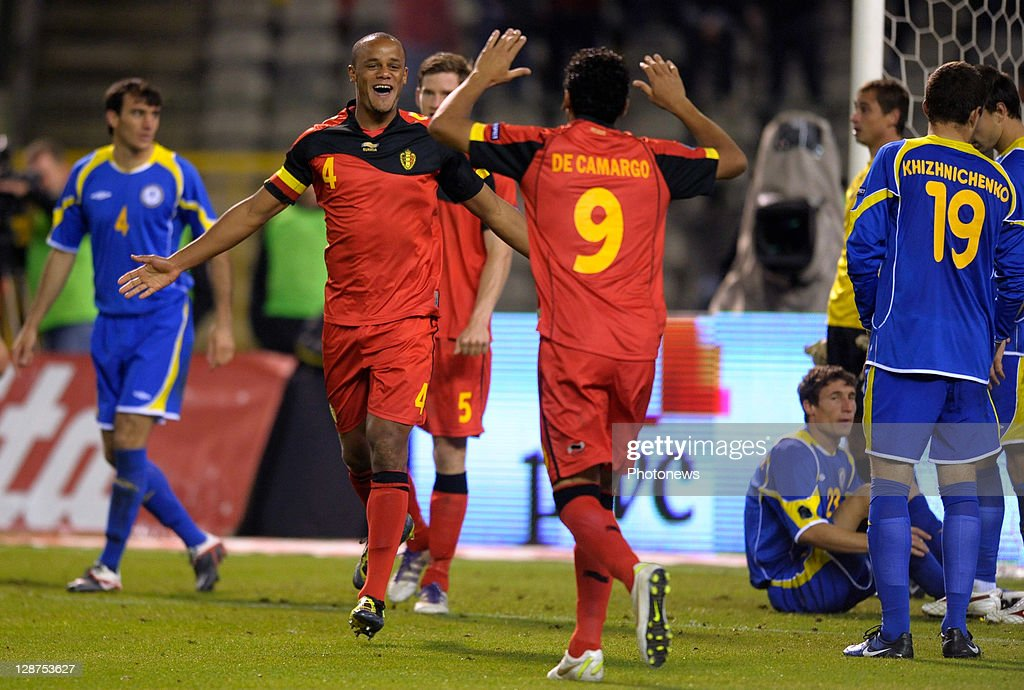 Vincent Kompany (centre L) of Belgium celebrates with team-mate Igor De Camargo after scoring the 3-0 goal for their team during the UEFA EURO 2012 Group A qualifying match between Belgium and Kazakhstan at King Baudouin Stadium on October 7, 2011 in Brussels, Belgium.