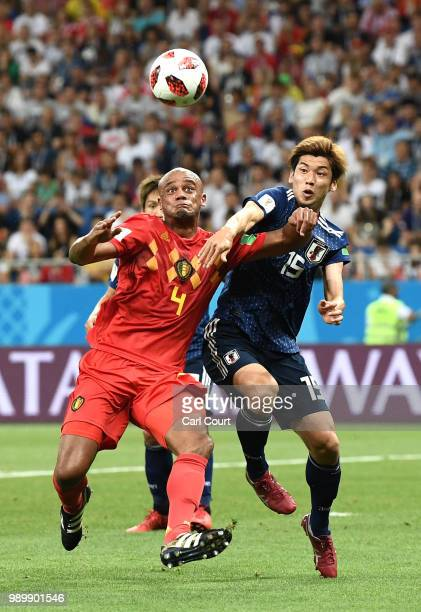Vincent Kompany of Belgium challenge for the ball with Yuya Osako of Japan during the 2018 FIFA World Cup Russia Round of 16 match between Belgium...