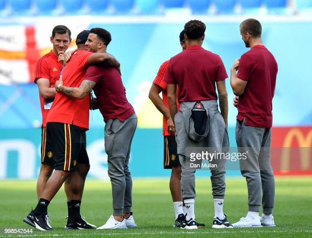 Vincent Kompany of Belgium greets Kyle Walker of England during a pitch inspection prior to the 2018 FIFA World Cup Russia 3rd Place Playoff match...