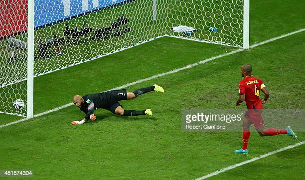 Vincent Kompany of Belgium has his shot saved by Tim Howard of the United States during the 2014 FIFA World Cup Brazil Round of 16 match between...
