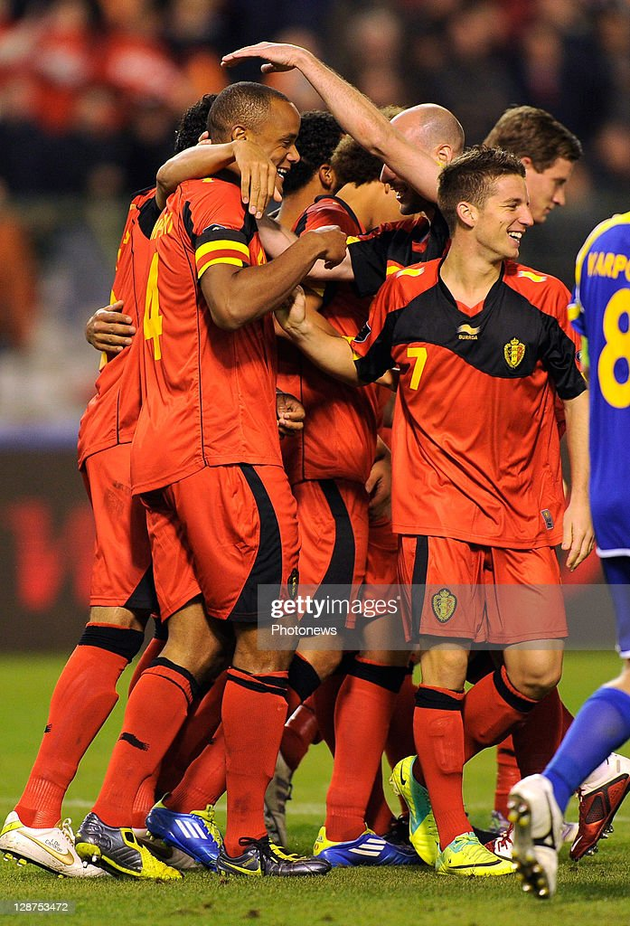 Vincent Kompany (L) of Belgium is congratulated by team-mates after scoring the 3-0 goal during the UEFA EURO 2012 Group A qualifying match between Belgium and Kazakhstan at King Baudouin Stadium on October 7, 2011 in Brussels, Belgium.
