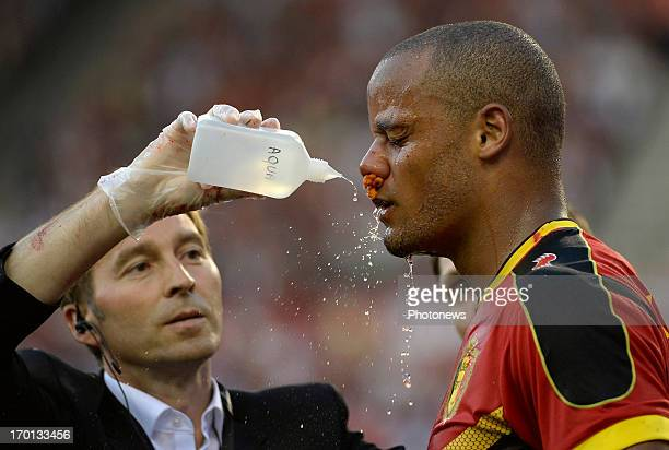 Vincent Kompany of Belgium receives medical attention during the FIFA 2014 World Cup Group A qualifying match between Belgium and Serbia at the King...