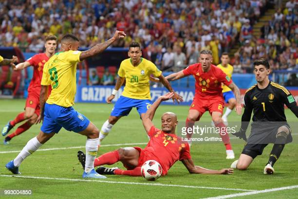 Vincent Kompany of Belgium tackles Gabriel Jesus of Brazil inside the penalty area during the 2018 FIFA World Cup Russia Quarter Final match between...