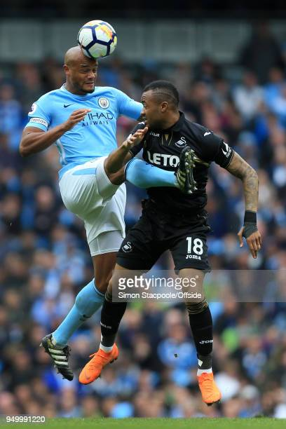 Vincent Kompany of Man City battles with Jordan Ayew of Swansea during the Premier League match between Manchester City and Swansea City at the...
