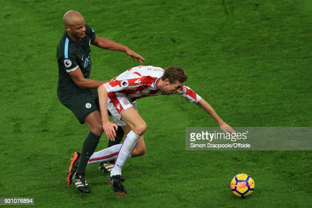 Vincent Kompany of Man City battles with Peter Crouch of Stoke during the Premier League match between Stoke City and Manchester City at the Bet365...