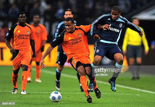 Vincent Kompany of Manchester challenges Jefferson Farfan of Schalke during the UEFA Cup Group A match between FC Schalke 04 and Manchester City at...
