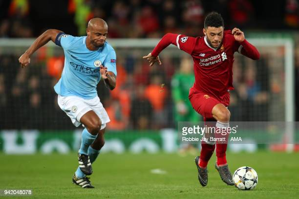 Vincent Kompany of Manchester City and Alex OxladeChamberlain of Liverpool during the UEFA Champions League Quarter Final first leg match between...