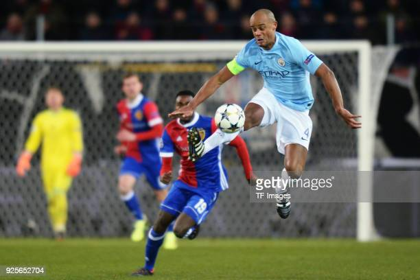 Vincent Kompany of Manchester City and Dimitri Oberlin of Basel battle for the ball during the UEFA Champions League Round of 16 First Leg match...
