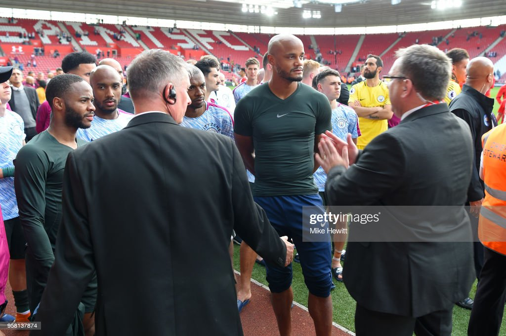 Vincent Kompany of Manchester City and his team mates are made to wait before celebrating with their fans after the Premier League match between Southampton and Manchester City at St Mary's Stadium on May 13, 2018 in Southampton, England.