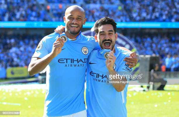 Vincent Kompany of Manchester City and Ilkay Gundogan of Manchester City celebrate with their winners medals after the Premier League match between...