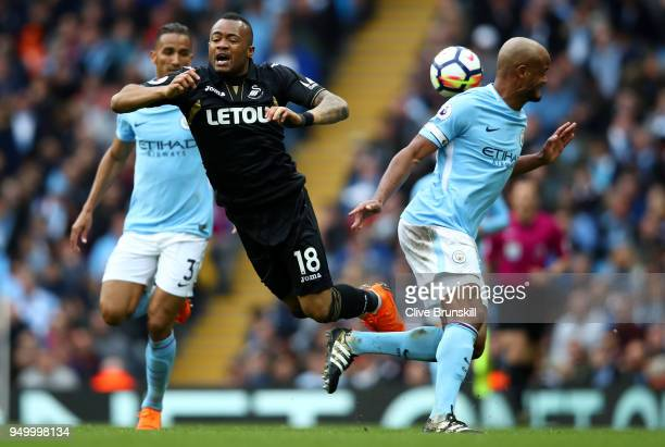 Vincent Kompany of Manchester City and Jordan Ayew of Swansea City battle for the ball during the Premier League match between Manchester City and...