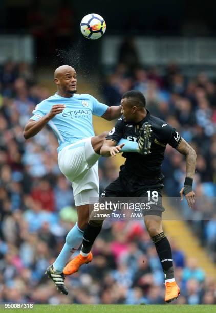 Vincent Kompany of Manchester City and Jordan Ayew of Swansea City during the Premier League match between Manchester City and Swansea City at Etihad...
