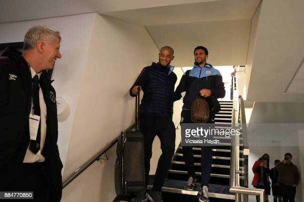 Vincent Kompany of Manchester City and Kyle Walker of Manchester City arrive at the stadium prior to the Premier League match between Manchester City...