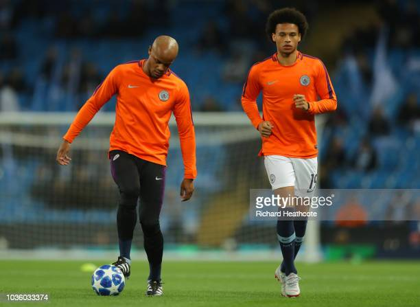 Vincent Kompany of Manchester City and Leroy Sane of Manchester City warm up prior to the Group F match of the UEFA Champions League between...