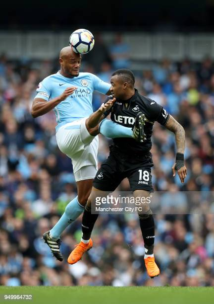 Vincent Kompany of Manchester City and Mame Biram Diouf of Stoke City during the Premier League match between Manchester City and Swansea City at...
