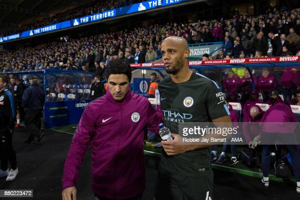 Vincent Kompany of Manchester City and Mikel Arteta assistant head coach / manager of Manchester City during the Premier League match between...
