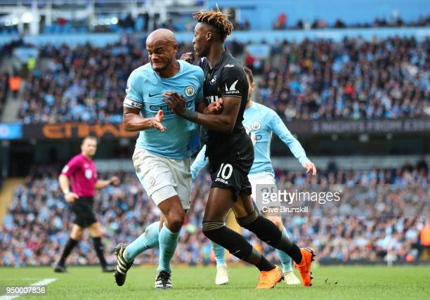 Vincent Kompany of Manchester City and Tammy Abraham of Swansea City clash during the Premier League match between Manchester City and Swansea City...