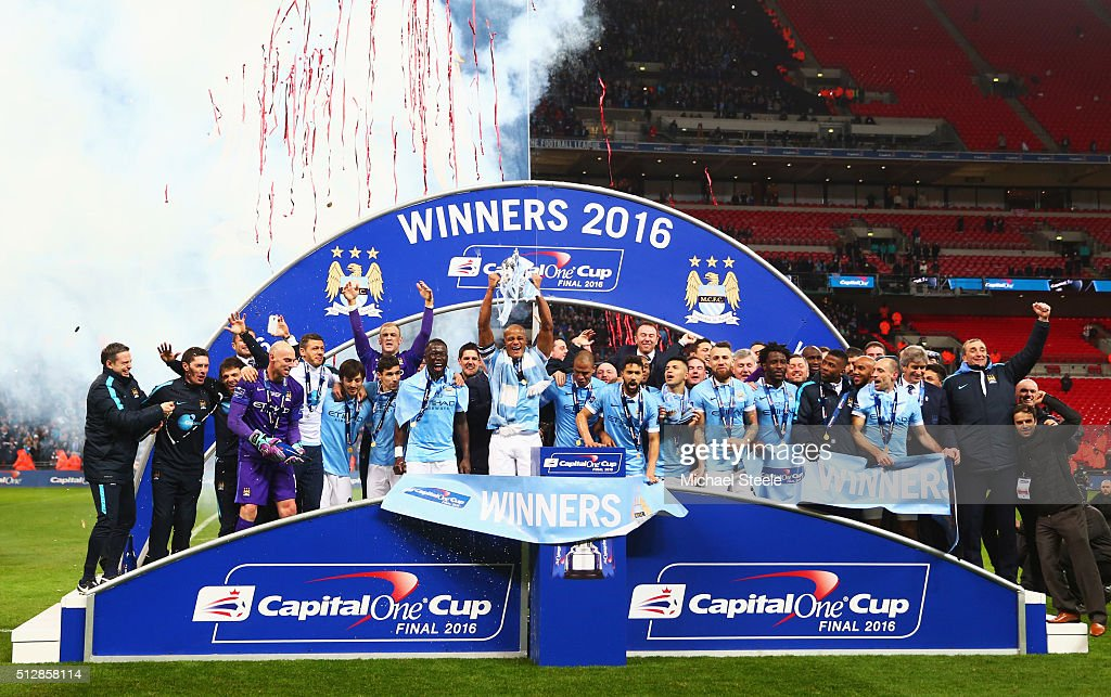 Vincent Kompany of Manchester City and team mates celebrate victory with the trophy after the Capital One Cup Final match between Liverpool and Manchester City at Wembley Stadium on February 28, 2016 in London, England. Manchester City win 3-1 on penalties.