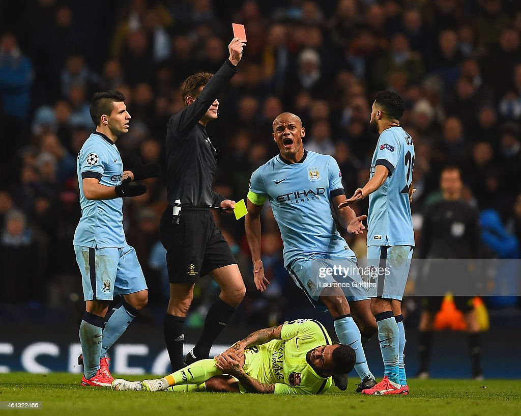 Vincent Kompany of Manchester City appeals as Referee Dr. Felix Brych shows Gael Clichy of Manchester City a red card during the UEFA Champions League Round of 16 match between Manchester City and Barcelona at Etihad Stadium on February 24, 2015 in Manchester, United Kingdom.