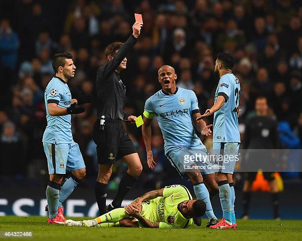 Vincent Kompany of Manchester City appeals as Referee Dr Felix Brych shows Gael Clichy of Manchester City a red card during the UEFA Champions League...