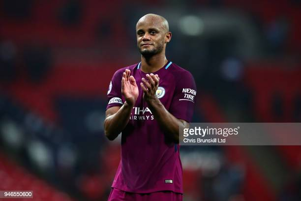 Vincent Kompany of Manchester City applauds the crowd after the Premier League match between Tottenham Hotspur and Manchester City at Wembley Stadium...