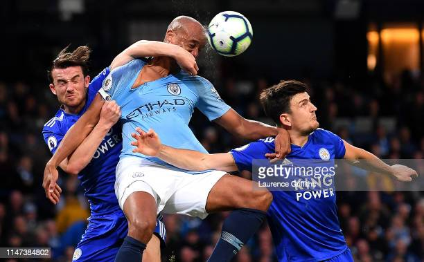 Vincent Kompany of Manchester City battles for possession with Ben Chilwell of Leicester City and Harry Maguire of Leicester City during the Premier...