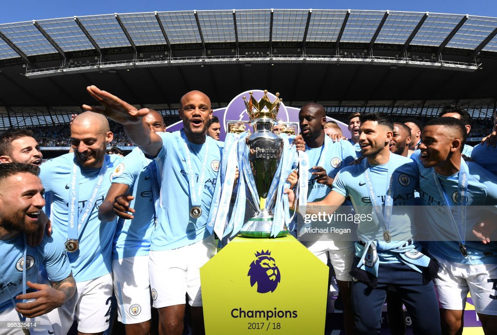 Vincent Kompany of Manchester City celebrate with The Premier League Trophy after the Premier League match between Manchester City and Huddersfield Town at Etihad Stadium on May 6, 2018 in Manchester, England.