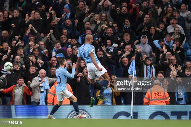 Vincent Kompany of Manchester City celebrates after scoring his team's first goal with Bernardo Silva of Manchester City during the Premier League...