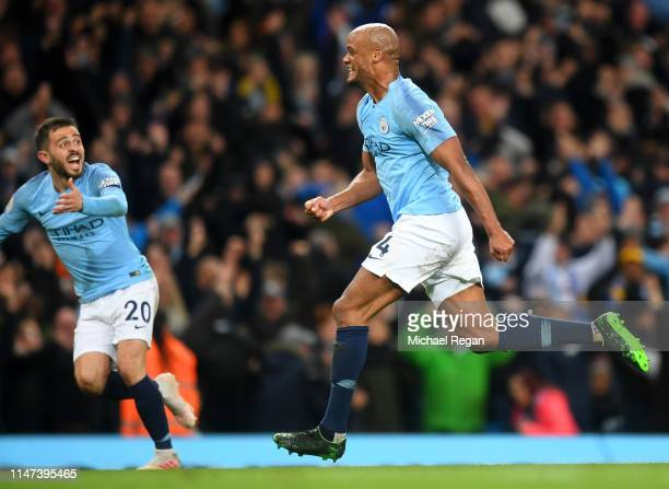 Vincent Kompany of Manchester City celebrates after scoring his team's first goal during the Premier League match between Manchester City and...
