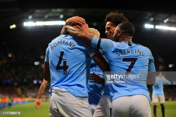 Vincent Kompany of Manchester City celebrates after scoring his team's first goal with Leroy Sane of Manchester City and Raheem Sterling of...