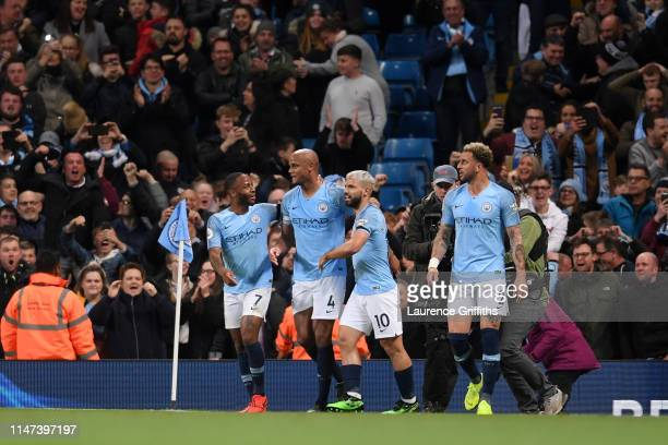 Vincent Kompany of Manchester City celebrates after scoring his team's first goal with Raheem Sterling of Manchester City and Sergio Aguero of...
