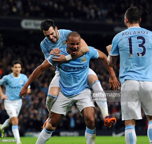Vincent Kompany of Manchester City celebrates after scoring the equlizing goal during the Barclays Premier League match between Manchester United and...