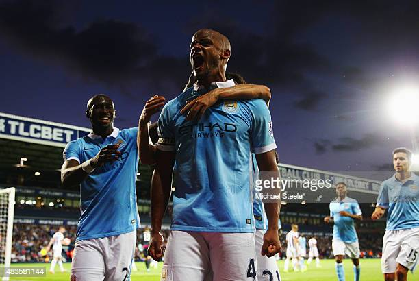 Vincent Kompany of Manchester City celebrates as he scores their third goal during the Barclays Premier League match between West Bromwich Albion and...
