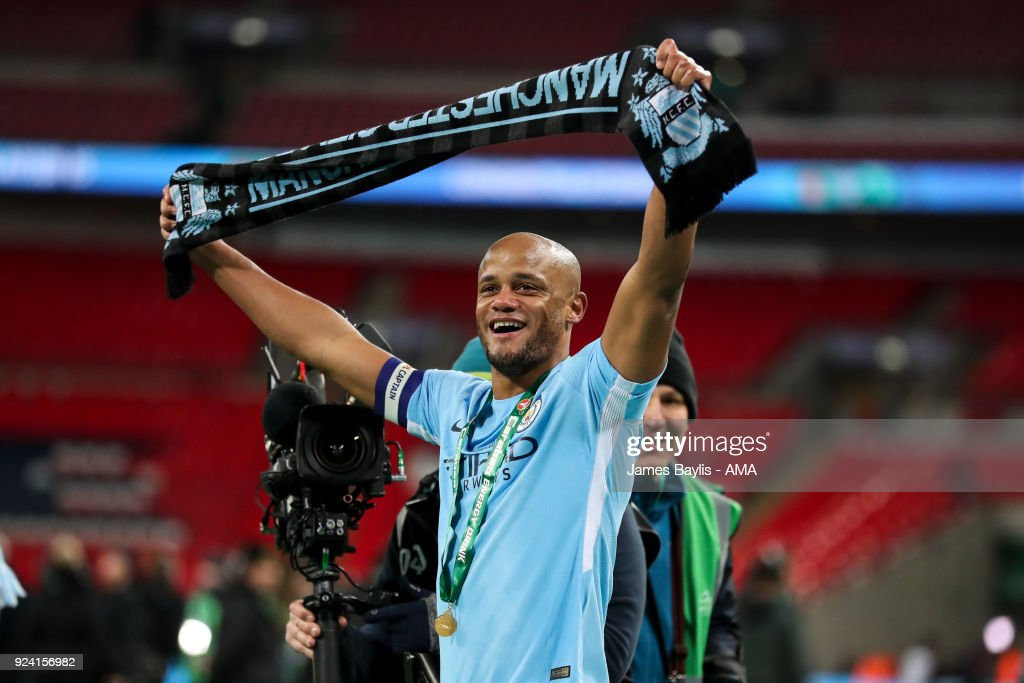Vincent Kompany of Manchester City celebrates at full time by holding a scarf aloft during the Carabao Cup Final match between Arsenal and Manchester City at Wembley Stadium on February 25, 2018 in London, England.