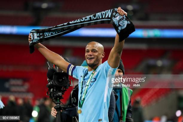 Vincent Kompany of Manchester City celebrates at full time by holding a scarf aloft during the Carabao Cup Final match between Arsenal and Manchester...
