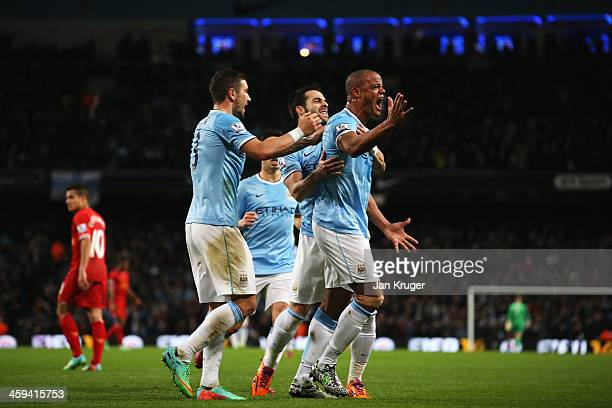 Vincent Kompany of Manchester City celebrates his team's first goal during the Barclays Premier League match between Manchester City and Liverpool at...