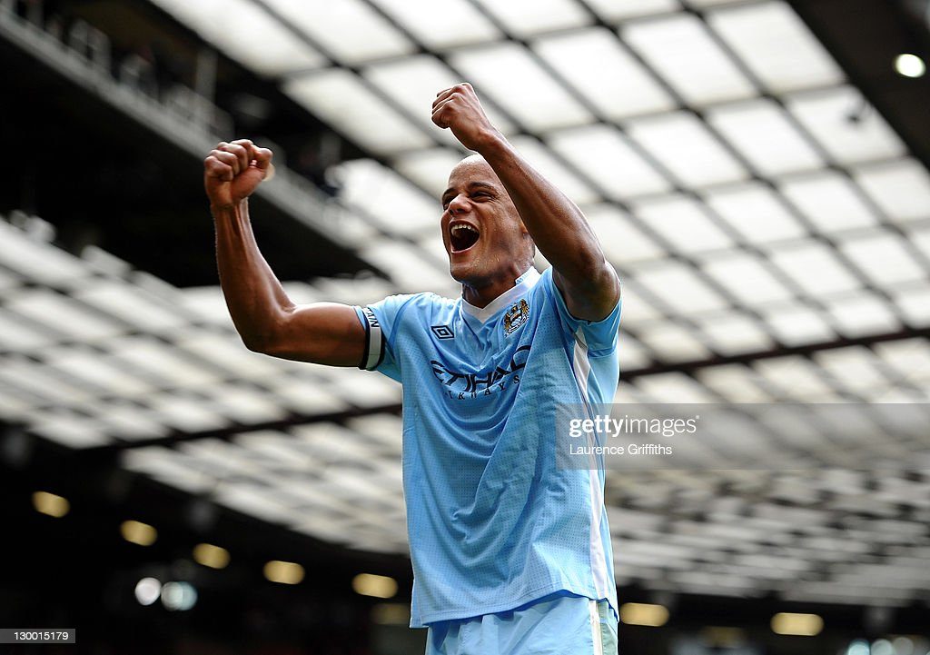 Vincent Kompany of Manchester City celebrates his team's victory at the end of the Barclays Premier League match between Manchester United and Manchester City at Old Trafford on October 23, 2011 in Manchester, England.