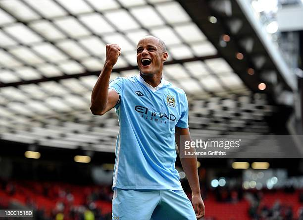 Vincent Kompany of Manchester City celebrates his team's victory at the end of the Barclays Premier League match between Manchester United and...