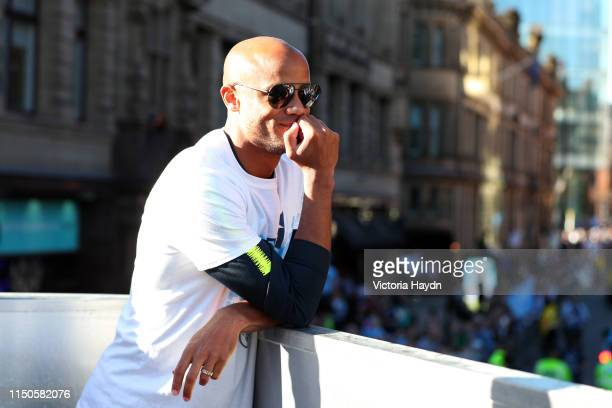 Vincent Kompany of Manchester City celebrates on board a parade bus during the Manchester City Teams Celebration Parade on May 20 2019 in Manchester...