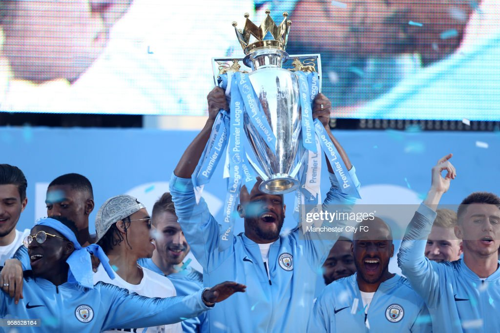 Vincent Kompany of Manchester City celebrates on stage while lifting the Premier League trophy during the Manchester City Trophy Parade on May 14, 2018 in Manchester, England.