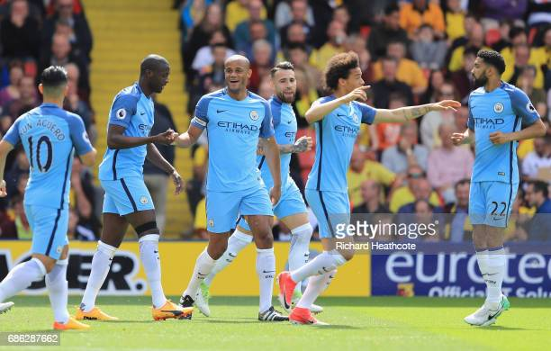 Vincent Kompany of Manchester City celebrates scoring his sides first goal with his Manchester City team mates during the Premier League match...