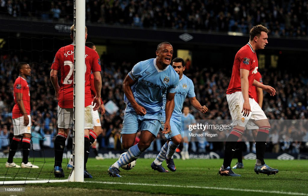 Vincent Kompany of Manchester City celebrates scoring the opening goal during the Barclays Premier League match between Manchester City and Manchester United at the Etihad Stadium on April 30, 2012 in Manchester, England.